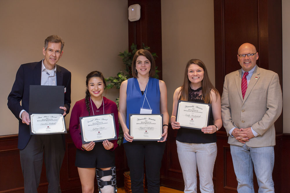 Dr. Wietse de Boer, Ms. Godard's faculty advisor, who accepted on her behalf as she currently studying abroad in Paris, France; Sydney Chuen; Abigail Culpepper; Emily Mendenhall; and Miami University President Dr. Greg Crawford pose for a photo at the Undergraduate Research Forum Luncheon on Wednesday, April 25, 2018.