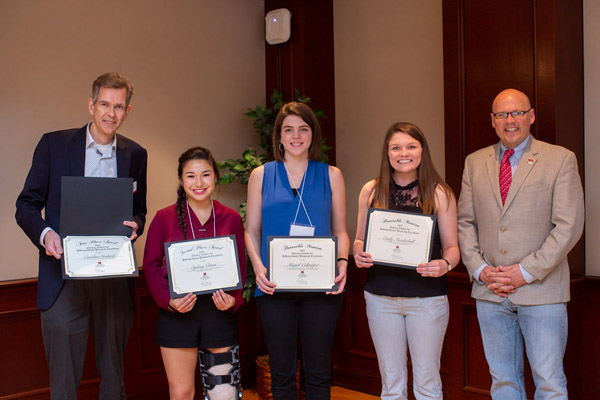 2018 LAURE winners, pictured left to right: Dr. Wietse de Boer, Caroline Godard's faculty adviser, who accepted on her behalf as she currently studying abroad in Paris, France; Sydney Chuen; Abigail Culpepper; Emily Mendenhall; with Miami University President Dr. Greg Crawford