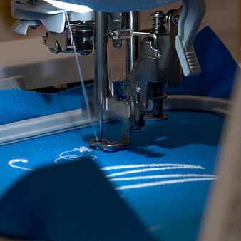 An embroidery machine in the King Library Makerspace is pictured applying a design to fabric